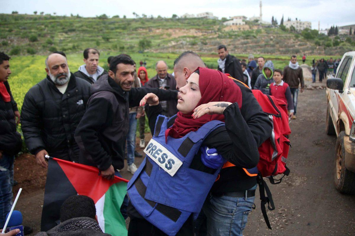 RAMALLAH, WEST BANK - MARCH 29: Health workers carry a wounded press member after israeli intervention during a protest against construction of Jewish settlement within 43rd anniversary of Palestinian Land Day in Ramallah, West Bank on March 29, 2019.  (Photo by Issam Rimawi/Anadolu Agency/Getty Images)