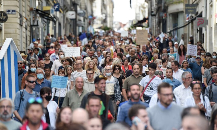 Demonstrators hold placards and chant slogans as they march during a rally in Nantes, western France, on September 18, 2021, to protest against the mandatory Covid-19 health pass to access most of the public space. (Photo by Sebastien SALOM-GOMIS / AFP) (Photo by SEBASTIEN SALOM-GOMIS/AFP via Getty Images)